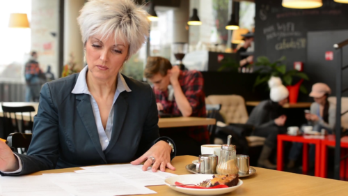 middle-aged-woman-reads-a-contract-papers-in-cafe-coffee-with-cake-and-tablet_si0rdj3ye_thumbnail-full01-500x281.png